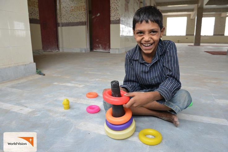 """Badal plays with #toys at a #WorldVision centre for children with special needs in #India. """"I love the centre and the #teachers who teach me here. They treat me well. They love me and I love them,"""" says Badal."""
