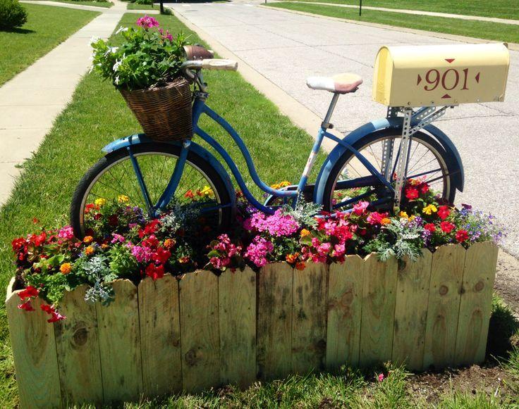 Fun use of a vintage bike - planter + mailbox!