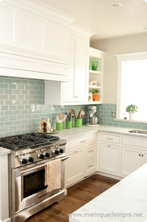 So Pretty! Love the white cabinets, blue backsplash with pops of green. I think these are the colors I want in my kitchen.