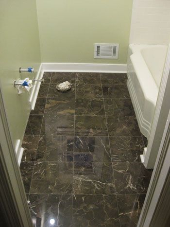 bathroom renovation how to install baseboards trim baseboards white
