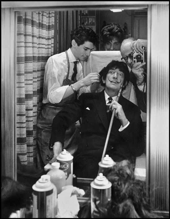 SPAIN. 1964. Yvonne and Philippe HALSMAN photographing Salvadore DALI in mirror.