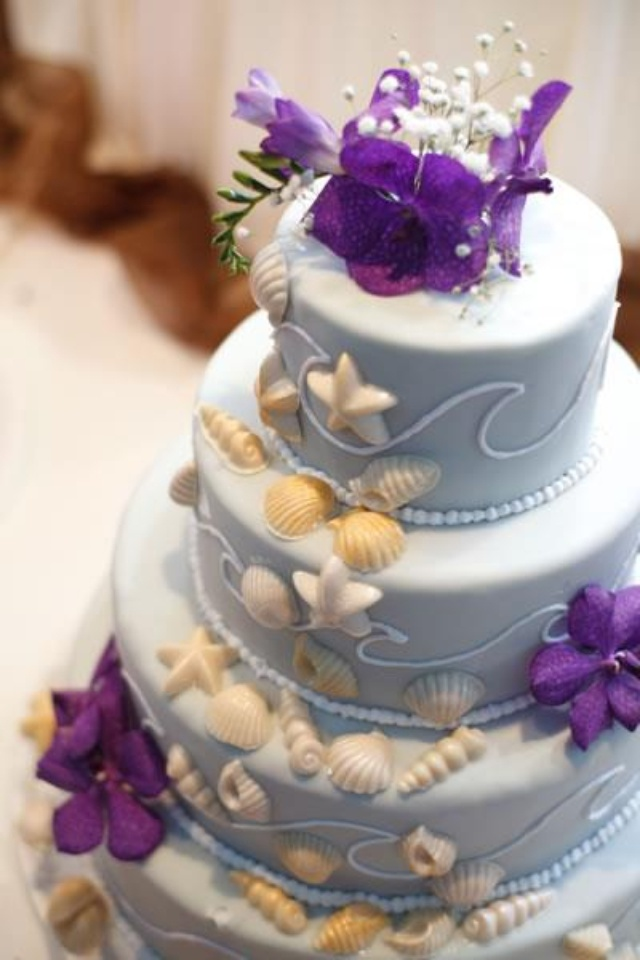 beach themed wedding cakes pinterest%0A Ocean themed wedding cake   tiers  purple flowers and seashells