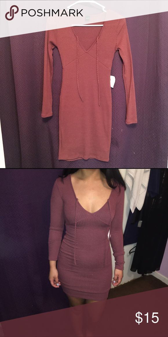 Dark Blush dress cute ,  tight fitting dress.   very pretty , dark blush color,   brand new with tags still attached !    i'm usually a medium,   so it's very tight on me in the second picture lol.    it would for someone a little smaller perfectly !    the top picture is my my room lighting ,  and the second picture is with flash on.   true color is the top picture. Dresses Midi