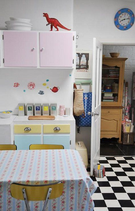 #Retro pastels help transform simplified kitchens on a budget. Checkered tile? Oh, yes...