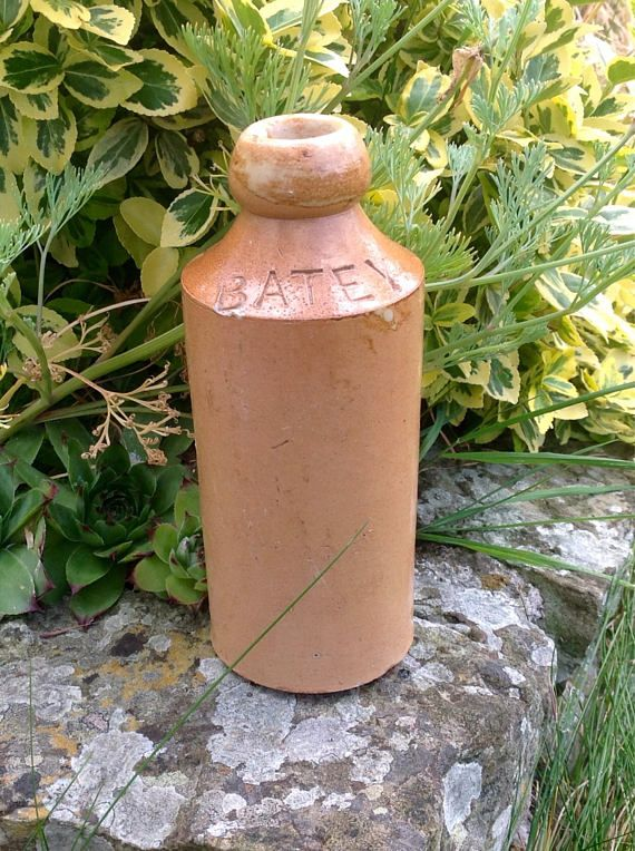 A tan coloured stoneware bottle ,made by Batey & Co. of Doulton, Lambeth in the late 1800s. William Batey started his Ginger Beer factory in 1853 on the south side of the Regents Canal...This is an early example of one of his Ginger Beer bottles. The bottle is 7 tall by 2.5 in diameter, and is quite heavy at 530g. Considering its great age , this bottle has survived well, there is a tiny chip under the letter B,.. and a couple of small shallow chips on the base , which are not visible ...