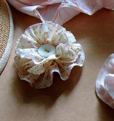 Fabric Flower by annekata, via Flickr. I tried to make one of these in the past (sans tutorial), but Kathrin's method is genius.