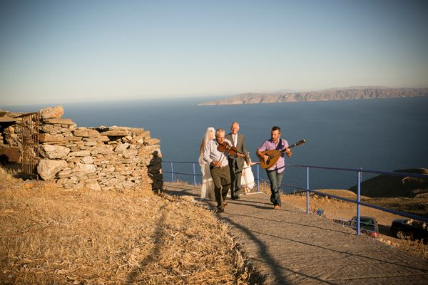 The bride was escorted to the church by her father while local musicians played traditional Greek wedding songs. http://www.love4wed.com/greek-island-wedding-kea/