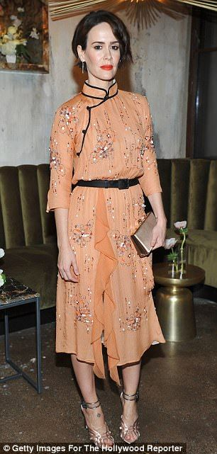 Sarah Paulson, 42, (left) opted for a floaty orange dress embellished with colorful sequins while Busy Philips, 37, (right) chose pale pink wide-legged pants with a white top and jacket