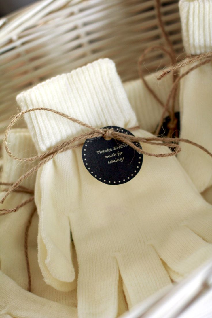 """Gloves as favors to stay with the """"Baby it's cold outside"""" theme. With labels that read """"Thanks SNOW much for coming!"""""""
