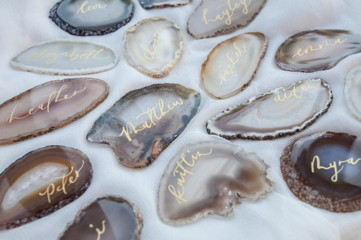 Metallic gold calligraphy names on agate slices.