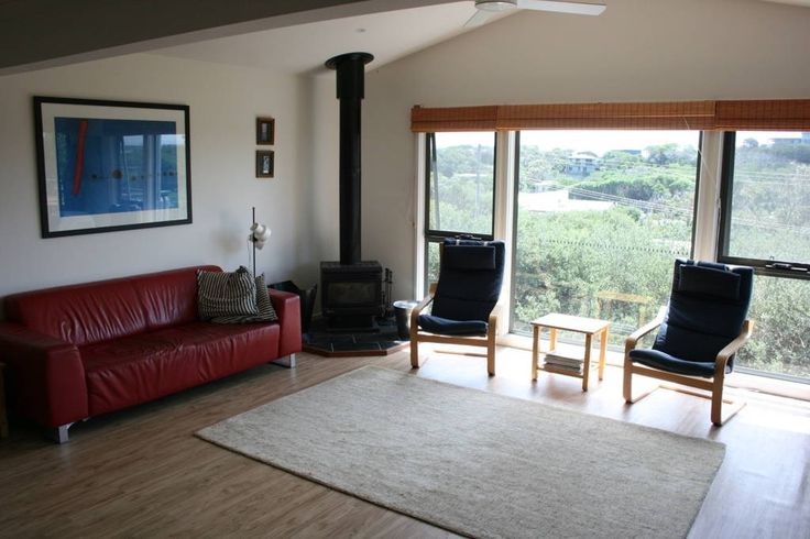 House in Sandy Point, Australia. Elevated fully appointed beach house with views.  Relaxing get-away for couples or a family.  Great location, 5 minutes walk to the beautiful Sandy Point beach and to the local shop.  30 minutes drive to Wilson's Promontory.  The beach house is lo...