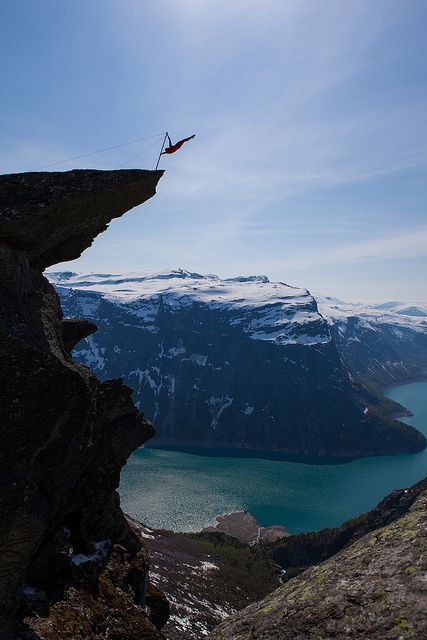 Trolltunga extreme [explored]    Eskil Rønningsbakken, a norwegian extreme artist, is doing a balancing act on the tip of the Troll's Tongue (Trolltunga). There is about 300 meters to the ground under him.