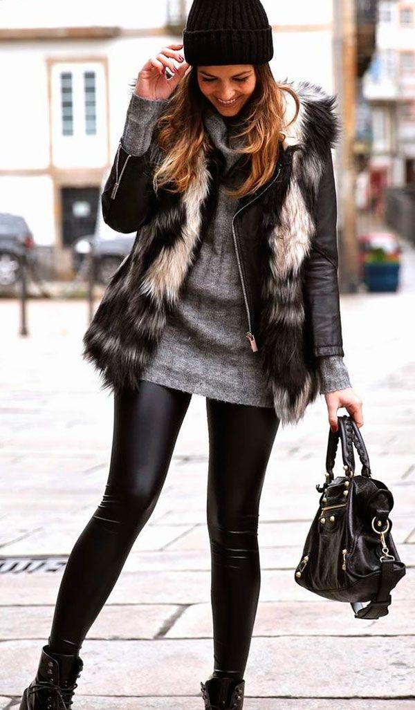 Look de frio com calça de couro, tricot, jaqueta de couro sob colete de pelos.