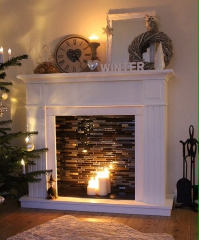 DIY faux fireplace with candles makes room warmer and cozy, perfect  decoration for Christmas time