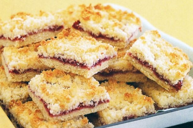 Raspberry Coconut slice. Great recipe, made two, one with apricot jam, and other raspberry jam. Would be delicious with lemon curd or other preserves!