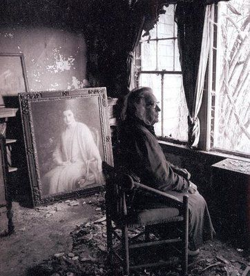 photo of Big Edie amid the decay of the house, with a portrait of her younger self looking on.