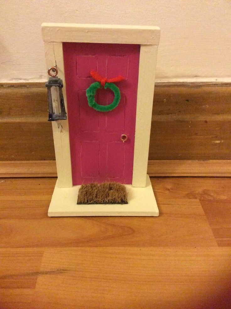 Miniature wooden fairy door with working fairy lantern for Wooden fairy doors