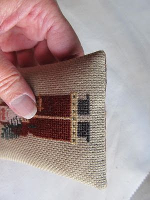 Neat technique for finishing your cross stitch ornament or pillow.  Samplers and Santas: The envelope please.....