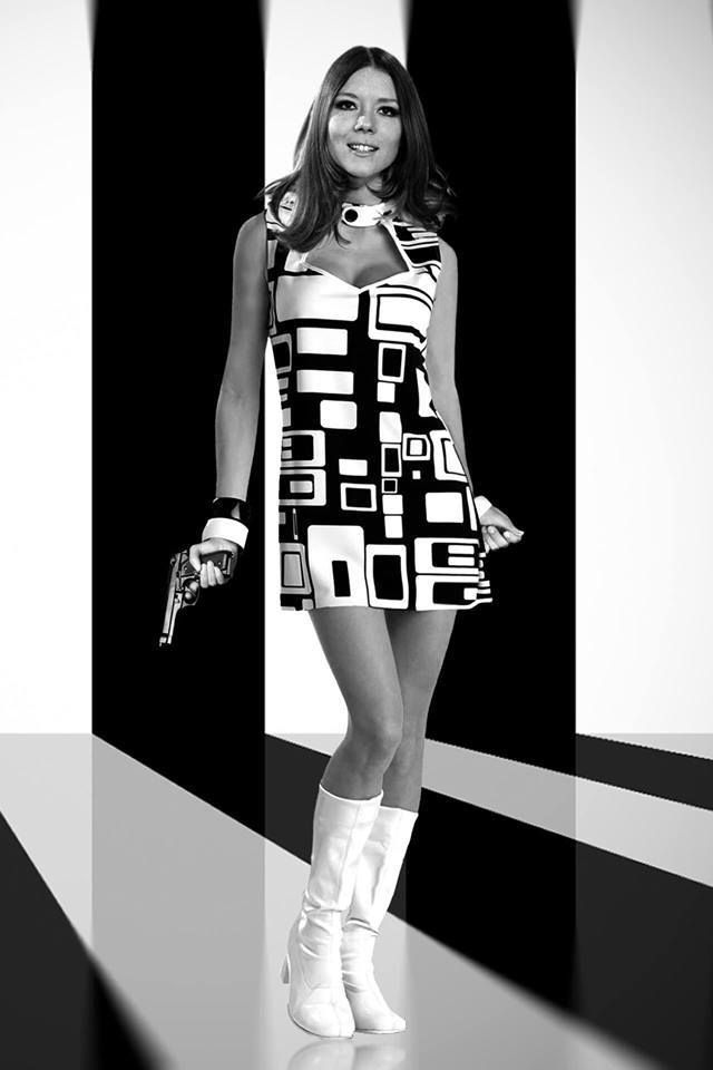 DIANA RIGG as Mrs Emma Peel The Avengers. For a fashion show. #sixties #whiteboots #emmapeel