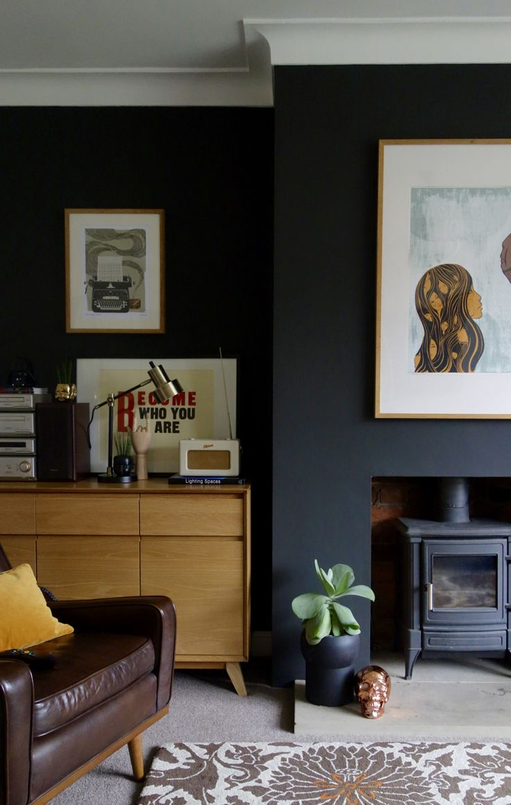 Black living room with Crown Night Fever. Eclectic mid century modern interior design with a quirk by Making Spaces.
