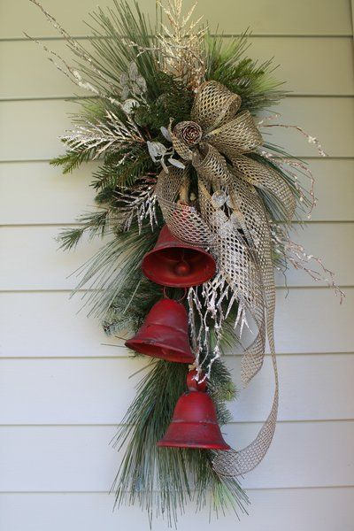 Rustic Farmhouse Metal Bell Swag Bring a touch of festive style to your entryway with a Rustic Farmhouse Metal Bell Swag.  SHOP www.exclusivelychristmas.com