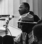 "Arguably the most recognized Alpha Phi Alpha member, Martin Luther King, Jr. delivered his ""I Have a Dream"" speech in front of the Lincoln Memorial during the 1963 March on Washington."