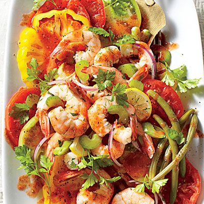 Bloody Mary Tomato Salad with Quick Pickled Shrimp | Mix and match colorful assorted tomatoes, such as 'Beefsteak,' 'Brandywine,' and 'Cherokee Purple.' Their rich, meaty flavor counters the dressing's tang and zip. | SouthernLiving.com