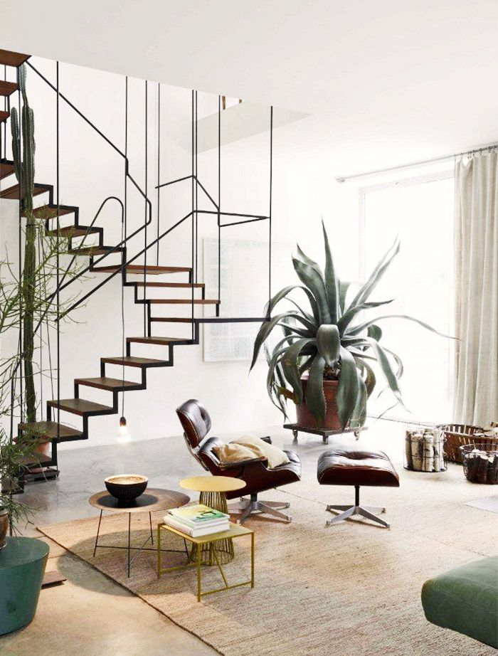 Wire stairs and modern living room with Eames lounge chair