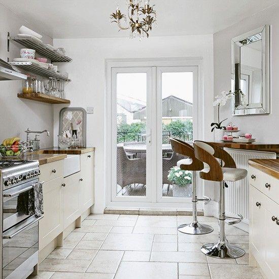 Modern cream kitchen with retro bar stools   housetohome.co.uk