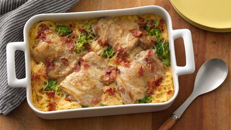 """Enjoy this creamy chicken casserole baked with chicken thighs, broccoli  and angel hair pasta. The bacon sprinkled on top adds to the """"yum"""" factor!"""