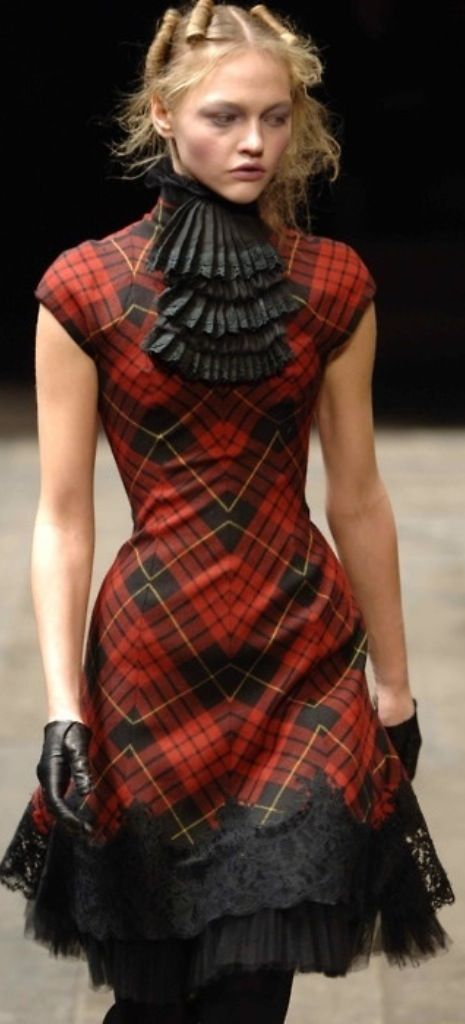 Alexander McQueen. Tartan dress, fitted and shaped dress in tartan