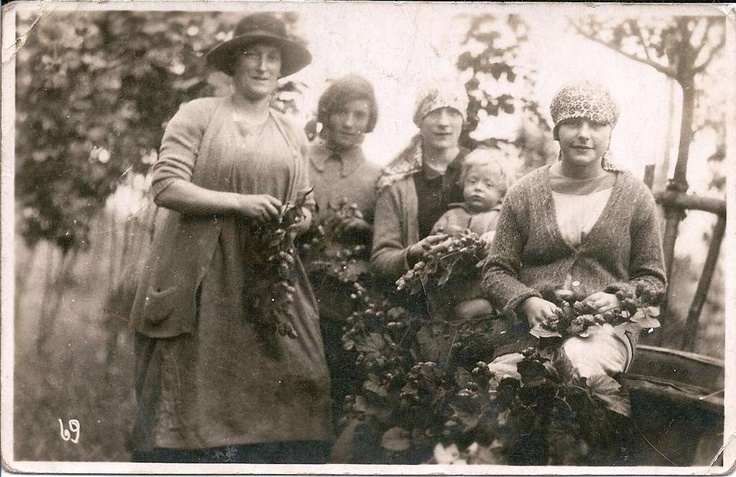 The small child is my father Ronald Wass. The family are hop picking in Kent. Abt 1928.