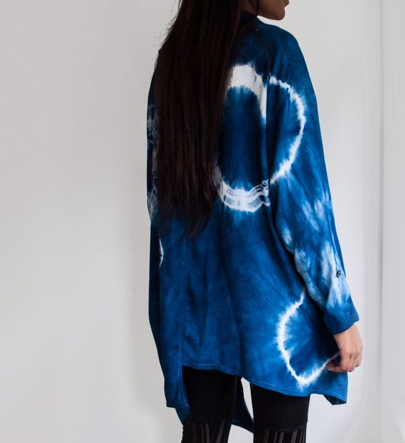 Indigo Dyed Rayon Flowing Blouse with a Bow / Rayon Blouse Hand dyed in deep indigo with Asymmetrical Hem / Shibori Rayon Top / Festival Top  This unique boho top is hand made from silky soft flowing rayon and dyed with natural indigo, with bold shibori circles and bow detail on the neckline.  Loosely fitting size S-M.  Please contact me if you have any questions about the sizes, pattern or our process! Pre-washed, one of a kind, wear with love