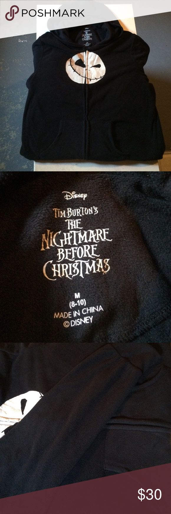 Nightmare Before Christmas Footie Pajamas Authentic Disney : Tim Burton footie pajamas. Black with glow in the dark jack skullington design. Working zipper. Attached footie slippers with grip bottoms and hoodie as well. Long sleeve. Has functional pockets. Extremely comfortable material. Worn once for a pajama party. Size medium.Condition 1-10: 10 . Disney Intimates & Sleepwear Pajamas