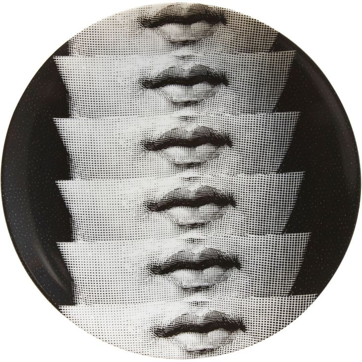 Fornasetti plate.  So odd yet so intriguing!