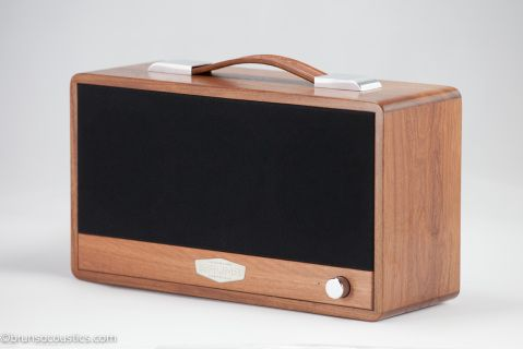 Ironbark is part of the Eucalyptus family. It is one of the hardest timbers in Australia. The strength and density of Ironbark can make it complicated to work with, but the end result is a product of true beauty.  Grain   matched from a single piece of Ironbark,  fitted with polished      hardware, hand dyed brown leather handle and a  solid black cloth grill.