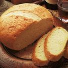Polenta Bread - uses 3 cups bread flour, 1/2 cup finely ground quick-cooking Italian polenta (plus more for baking sheet), 2 tsp. quick-rise yeast, 1 tsp. salt, 1 tbls. extra virgin olive oil, and 1 egg - rated 5 out of 5 on Williams Sonoma site.