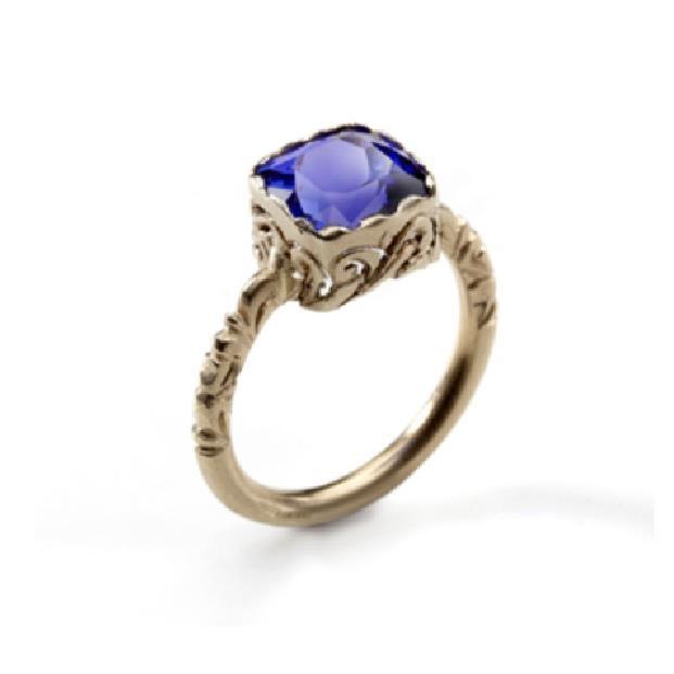 handmade golden ring with tanzanite gemstone .