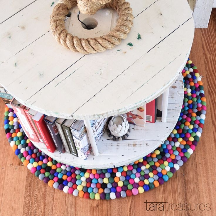 Happy Shelfie made of cable spool. On a Colourful felt ball rug from our stall. #colourpop #feltballrug
