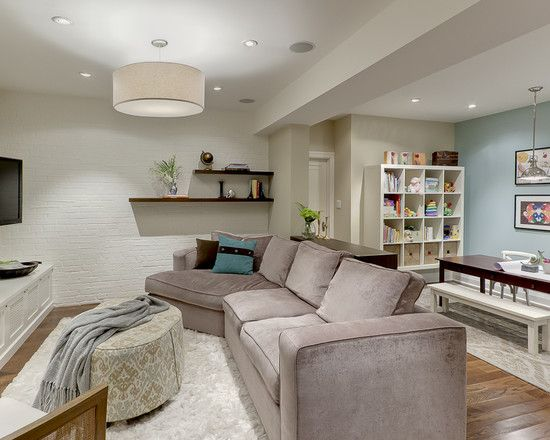 LOVE the colour style and layout of this basement. I am crazy about having a dining sized table in the basement. Perfect for fast food and movies, for sewing and crafts, and bigger family get togethers