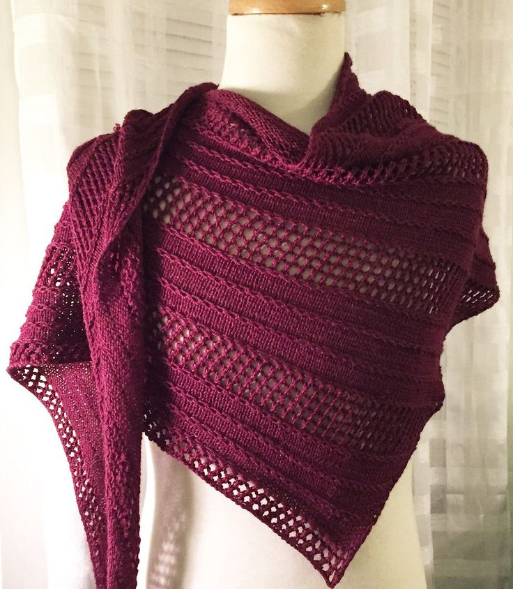 Knitting Pattern for Caprius Shawl - This asymmetrical, triangular shawl is knit from tip to end and alternates between a slip-stitch and eyelet sections, separated by simple stockinette stitch. Designed by Francoise Danoy.