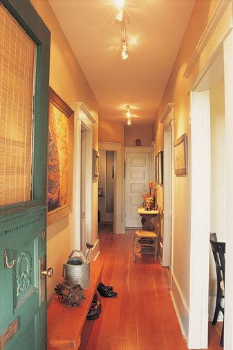 I'd love to see a bright chandelier or other bold set of light fixtures in this hallway. What I love about the current set up is the low, narrow bench. It's perfect for the space.