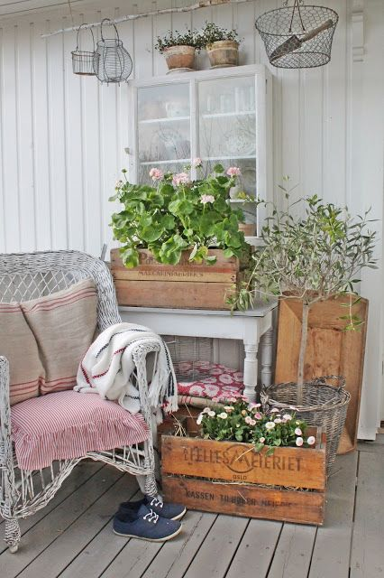 Love the crates with plants/flowers for the back porch.