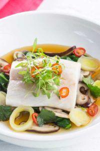 Sea bass with Japanese mushroom broth from Great British Chefs Martin Wishart.