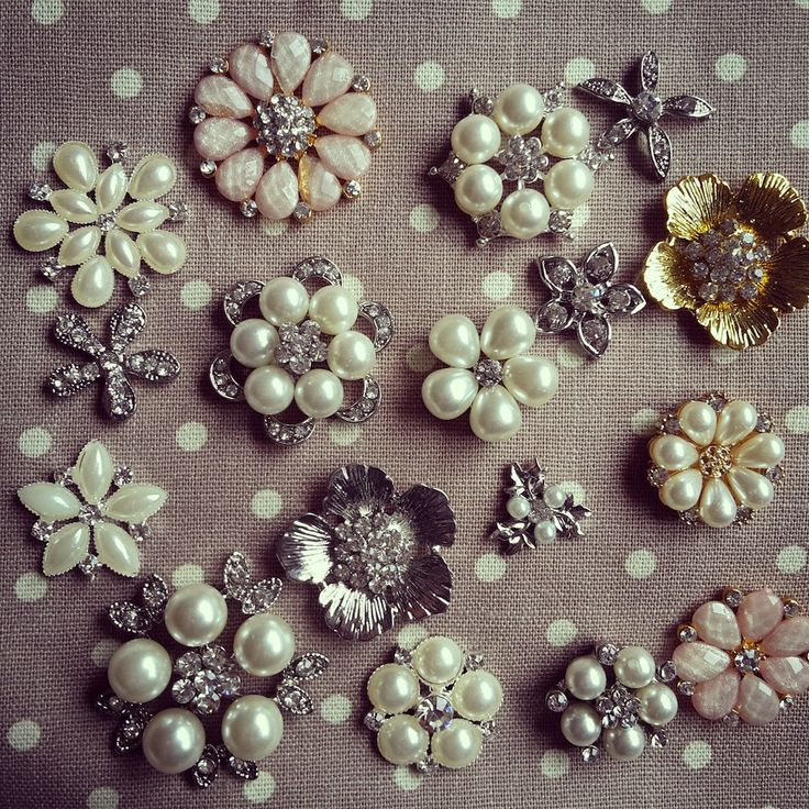 Look at these beautiful, flowery pearl and diamante embellishments for your wedding invitations...