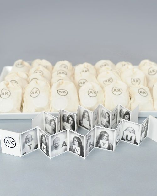 Accordion photo favor books. Note: with all favours, BAGS are easier to carry than boxes!