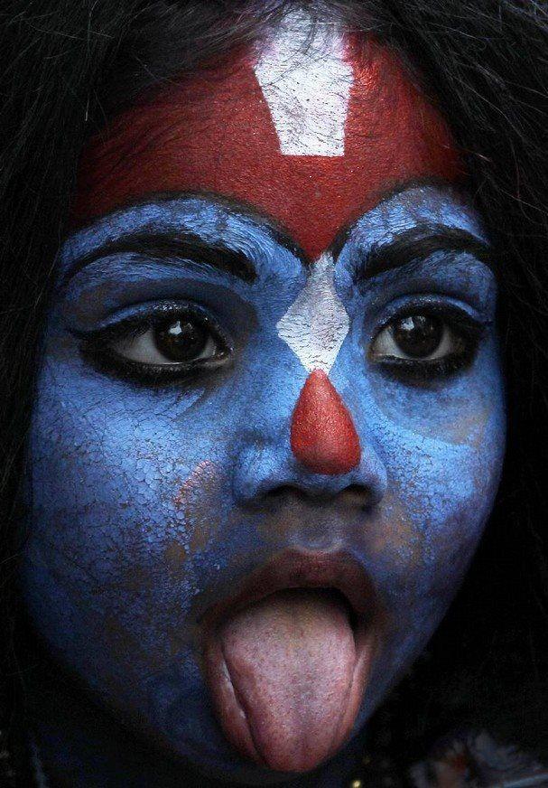 "mortem-et-necromantia: A young girl dresses as Hindu goddess Kali as people celebrate ""Gudi Padwa"" or the Marathi new year, in Mumbai, India."