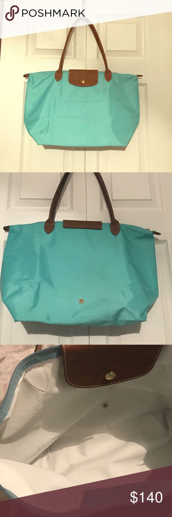 Longchamp Le Pliage Shopping Model Depose Rare Authentic Longchamp Tiffany Blue Le Pliage Shopping Modele Depose. This color is no longer in production and is a very coveted and rare color to find. Gorgeous with long top handles in brown leather. Gently used condition with some light signs of wear on the inside and on the back. Please see the photos and ask any questions! All sales Final. Happy Poshing 🎀 Longchamp Bags Totes