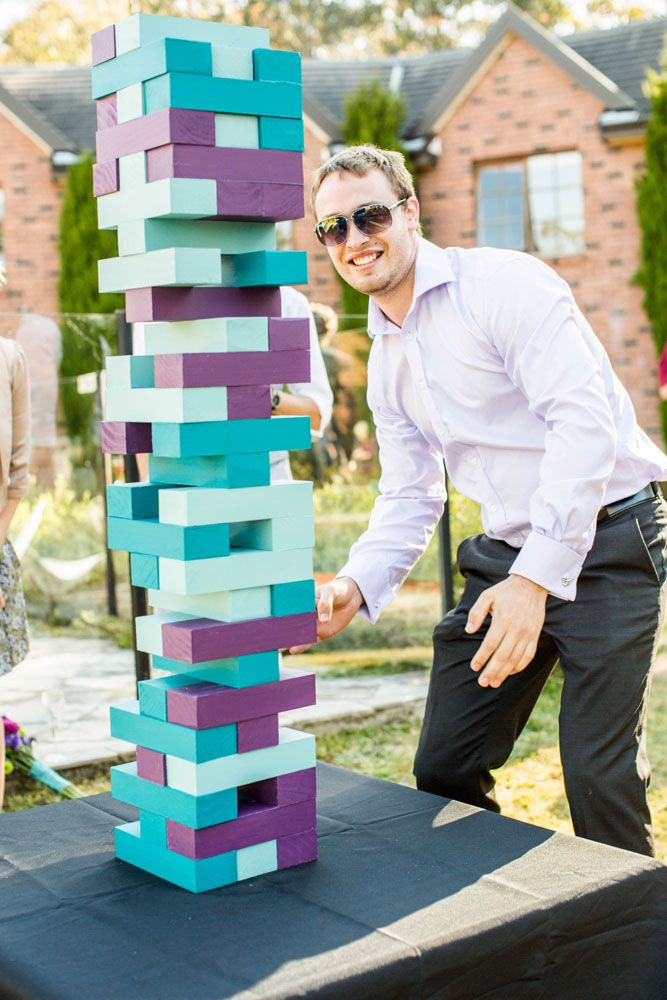 Teal and purple wedding giant Jenga · Rock n Roll Bride
