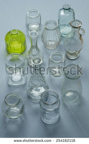 Multiple types of bottles and jars over blue background, top view